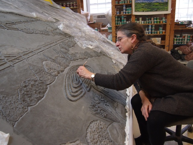 Karen adding texture to the labyrinth.